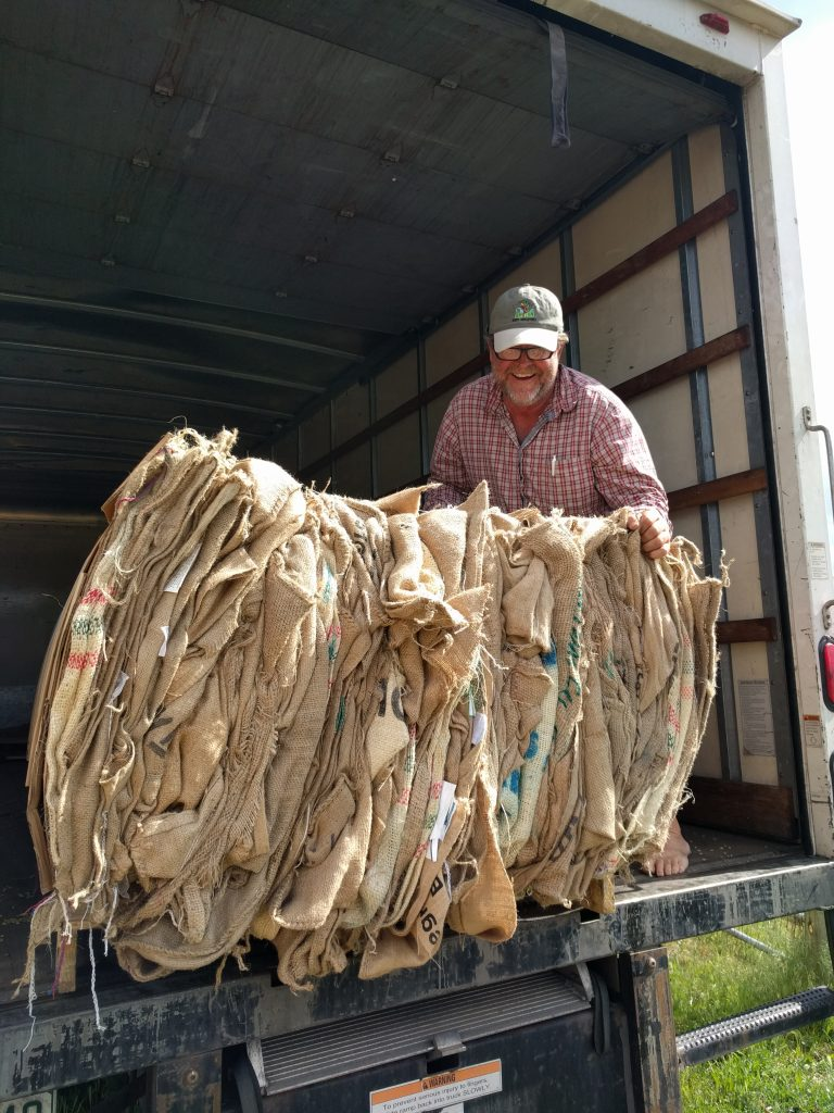 Ludie unloading burlap bags.