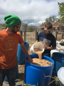 Mixing bokashi inoculant into garden waste